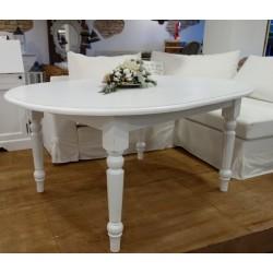 Owalny stół z toczonymi nogami